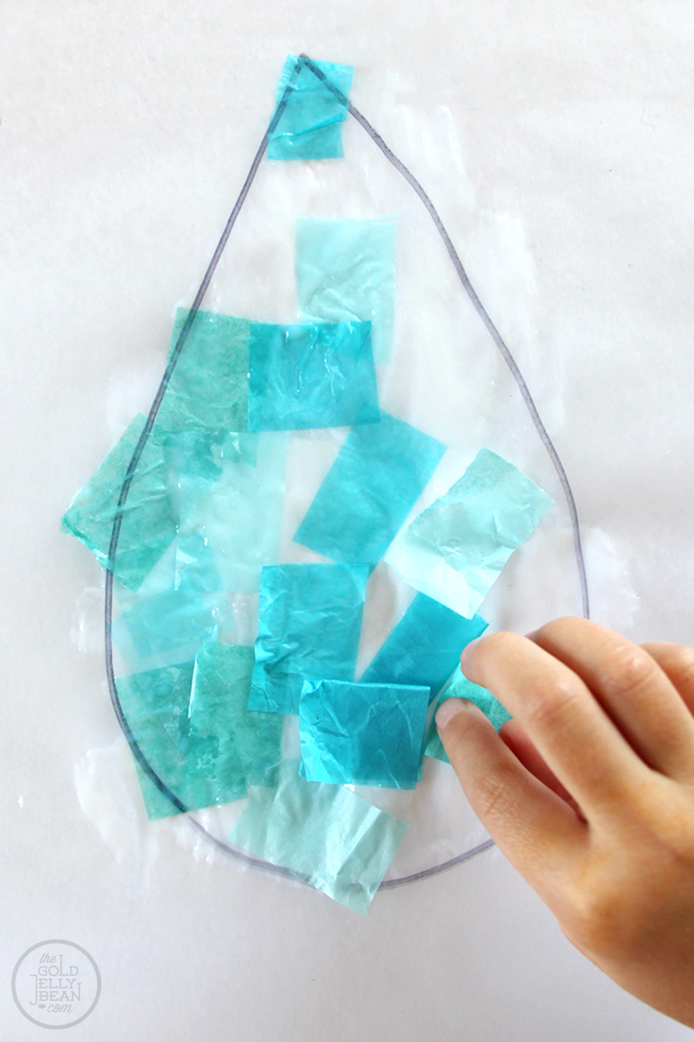 April Showers DIY Suncatcher Craft via www.thegoldjellybean.com